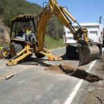 Backhoe-Excavating-Trench-for-Culvert
