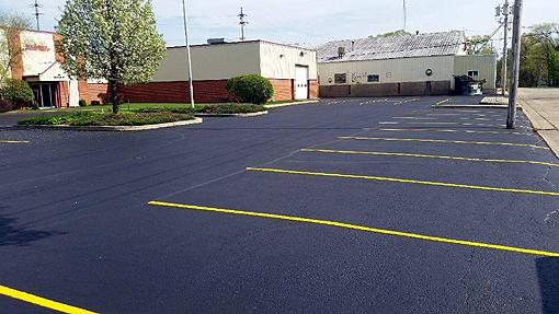 Rockford Acromatics Project:  Sealcoating, Crack Filling and Parking Lot Striping