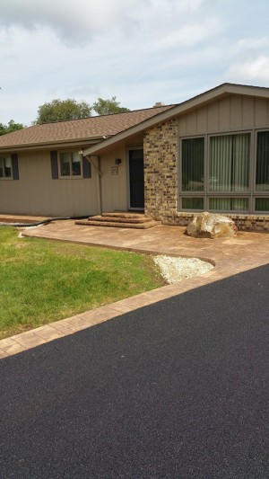 Asphalt Driveway and Decorative Concrete Front Deck Area